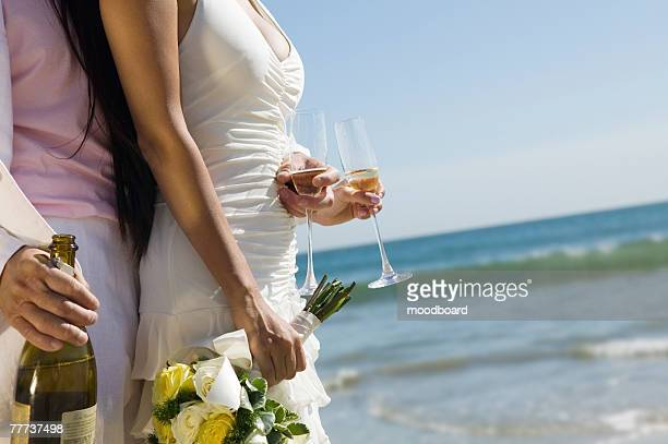 Bride and Groom Celebrating With Champagne