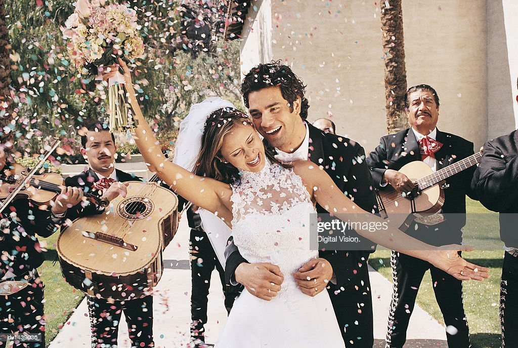 Bride and Groom Celebrating With Confetti and a Mariachi Band