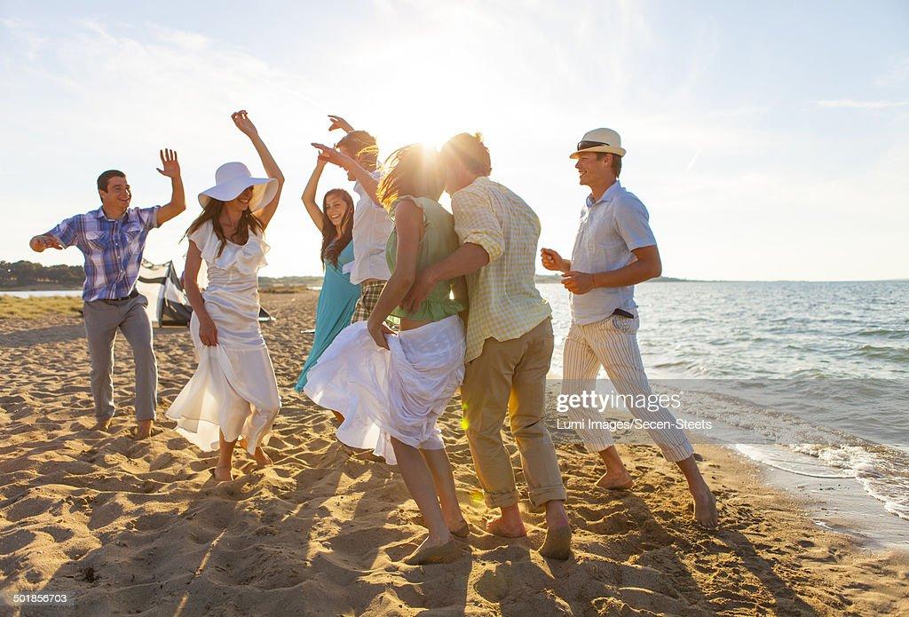 Bride and groom dancing on the beach, Dalmatia, Croatia