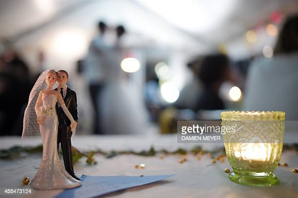 Bride and groom figurines are pictured on a table during a wedding party on september 13 2014 in HedeBazouges a suburb of Rennes western France AFP...