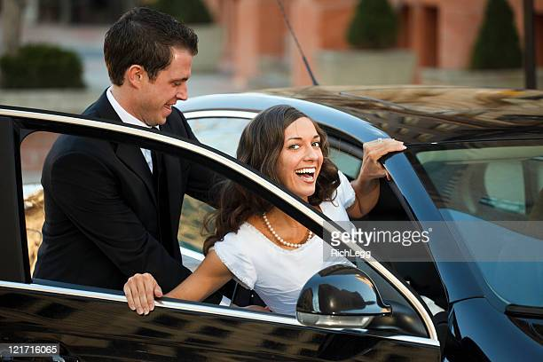 Bride and Groom Getting Into Car
