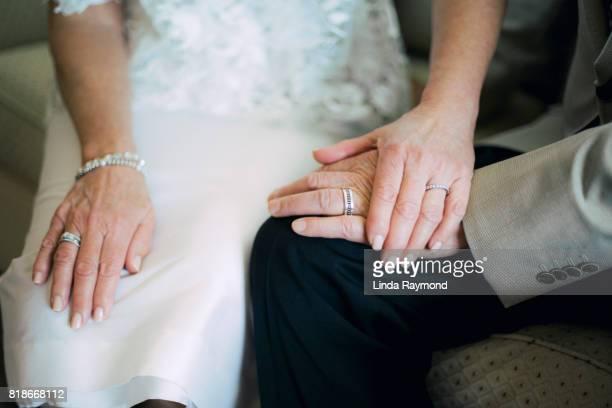 Bride and groom hands wearing wedding rings