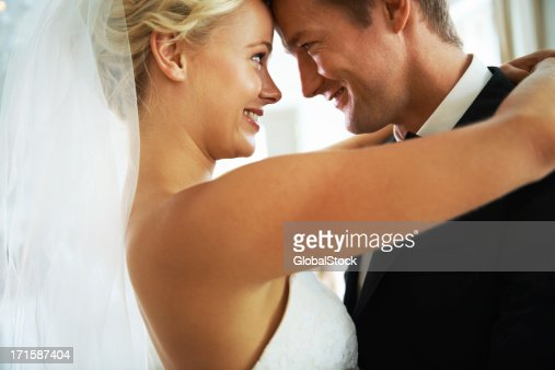 A bride and groom happily looking at each other