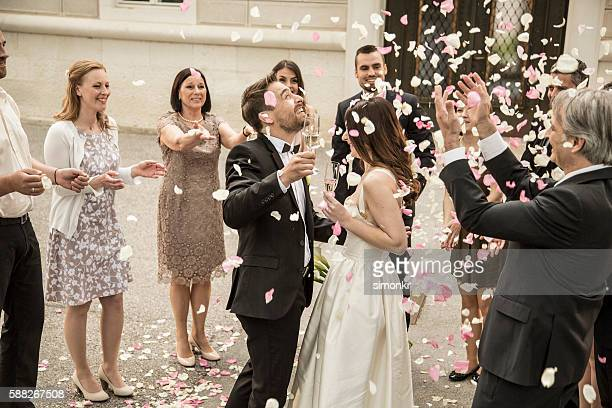 Bride and groom holding champagne flute