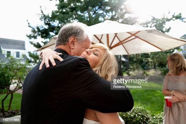Bride and groom hugging on wedding day
