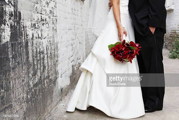 Bride and Groom in alley, Red bouquet