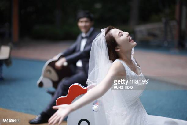 bride and groom in amusement parks