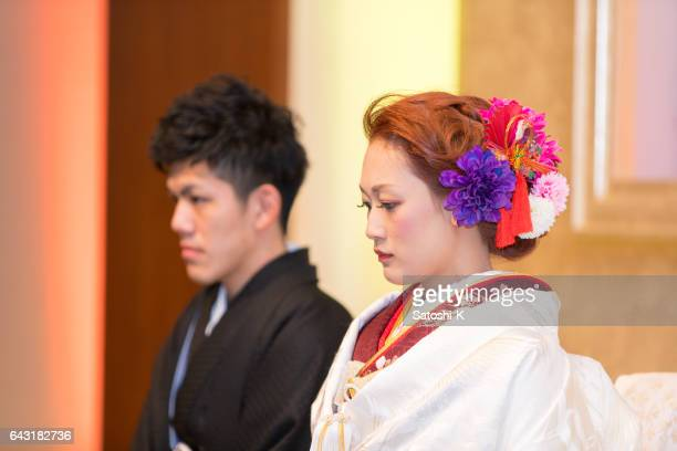 Bride and groom in chapel for wedding ceremony