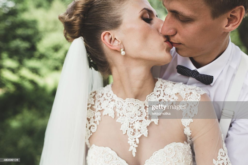 Bride and groom in the forest : Stock Photo