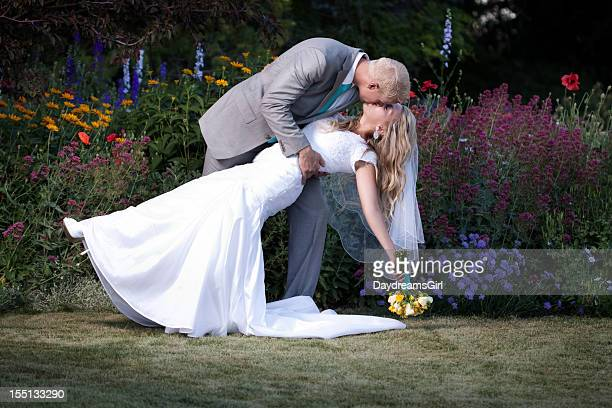 Bride and Groom Kissing in Nature Setting