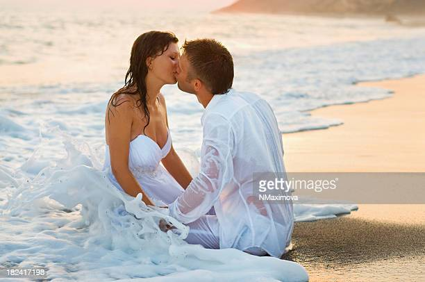 Bride and groom kissing on the beautiful beach