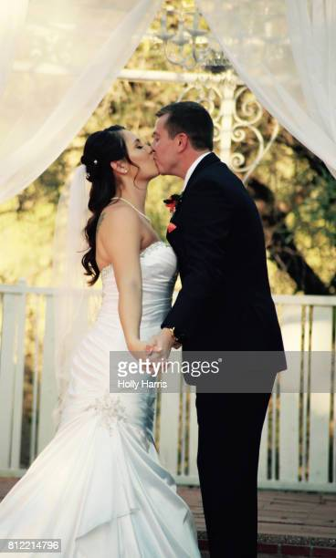Bride and groom kissing wedding ceremony