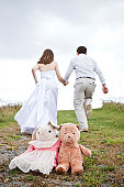 Bride and groom leaving childhood behind for a future together