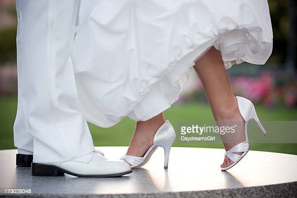 Bride and Groom Legs in White Wedding Gown Tuexedo Shoes