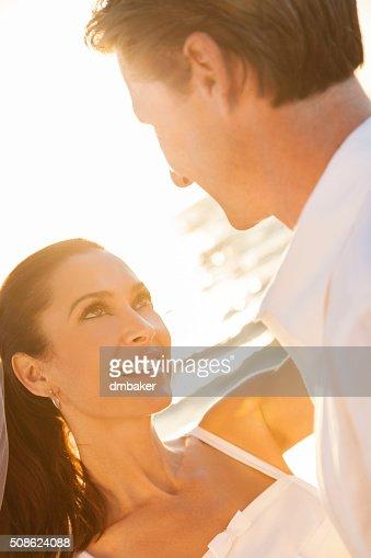 Bride and Groom Married Couple Sunset Beach Wedding : Stock Photo
