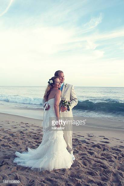 Bride and Groom on Beach at Sunset, Wedding Day