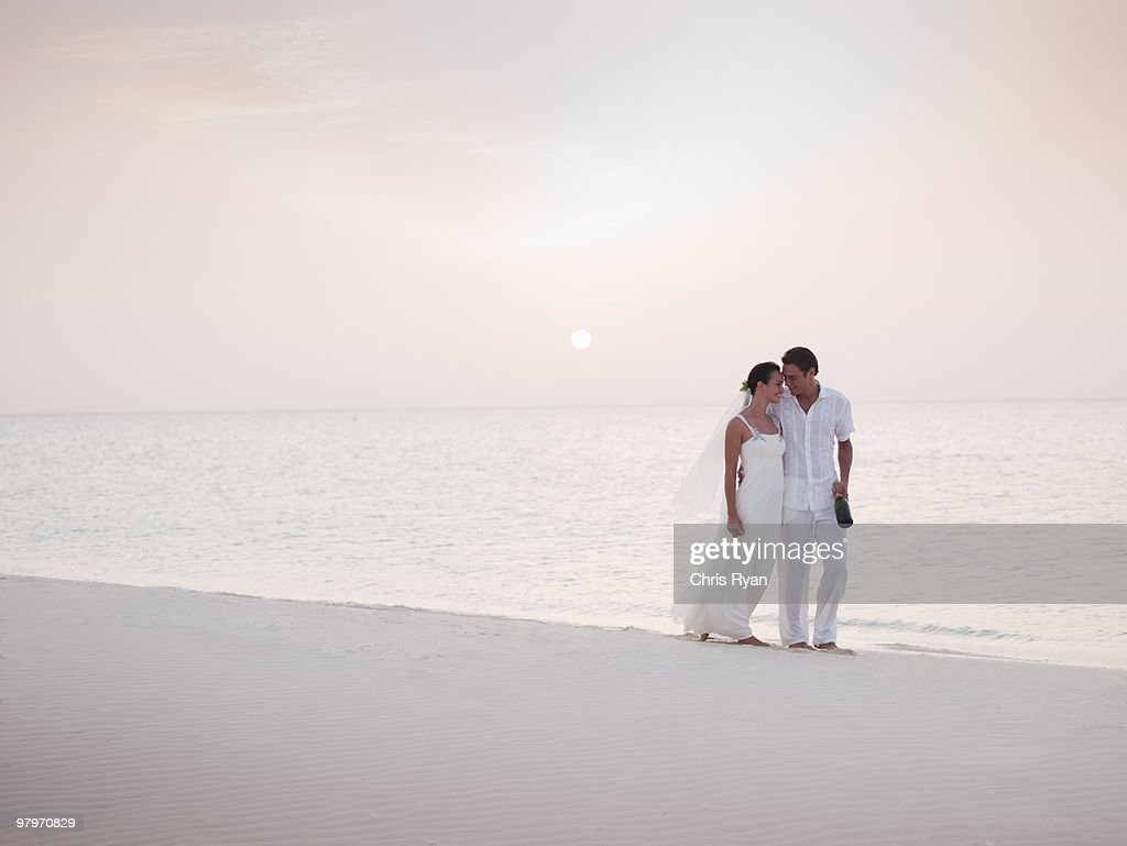 Bride and groom on beach : Stock Photo