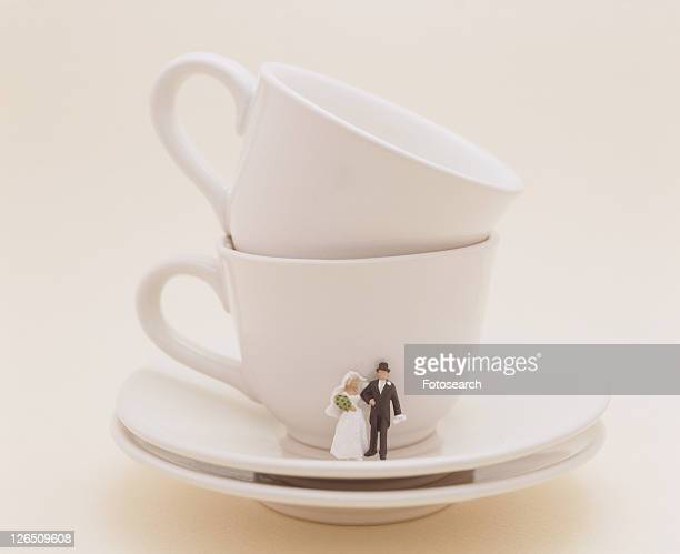 Bride And Groom On Saucer