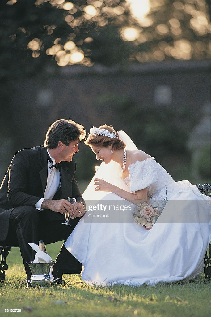Bride and groom outdoors : Stock Photo