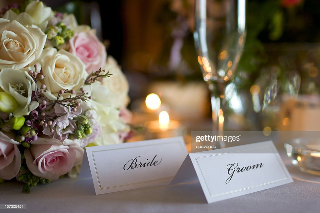 Bride and Groom Place Cards with Bouquet at Wedding Reception : Stock Photo