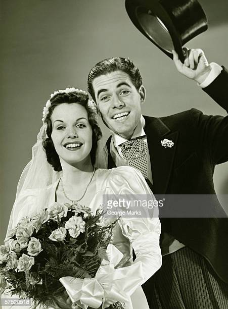 Bride and Groom posing in studio, (B&W), portrait
