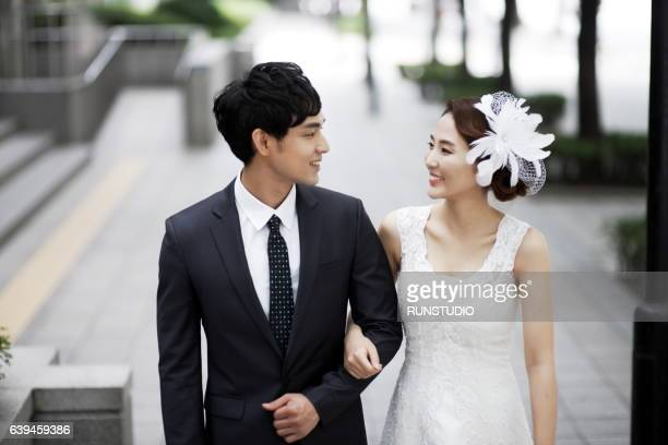 bride and groom posing together outdoors on a wedding day