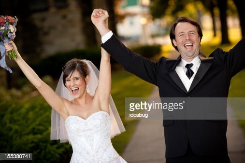 Bride and Groom Raising Their Hands in Celebration