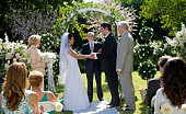 Bride and groom saying vows at wedding