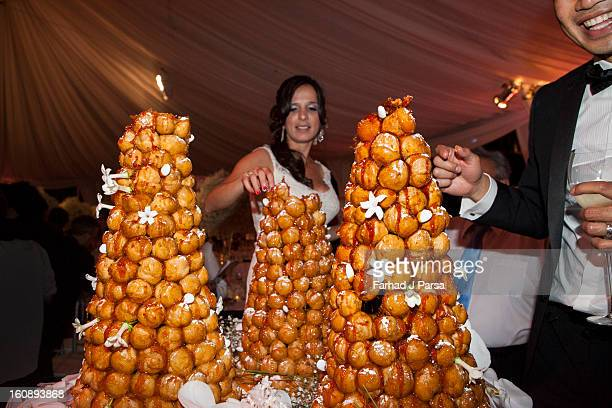 Bride and Groom share their croquembouche cake.