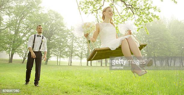 Bride and groom sitting in park