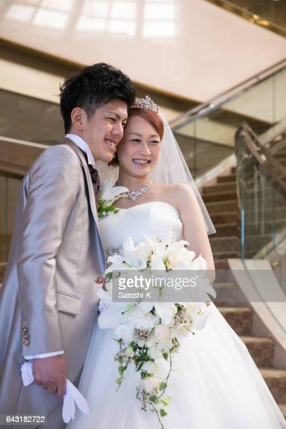 Bride and groom smiling on stairs