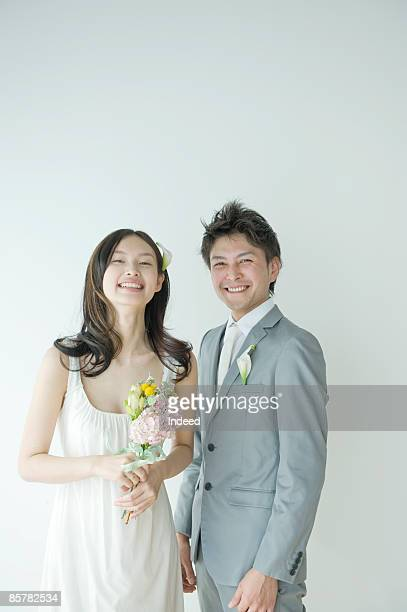 Bride and groom smiling, portrait