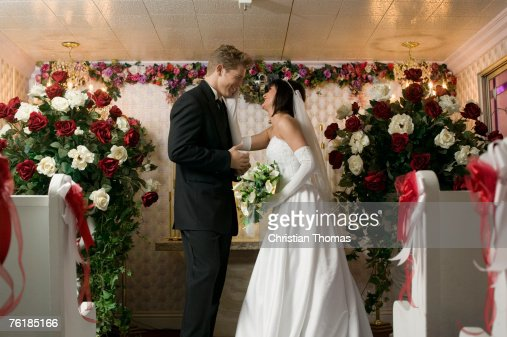 Bride and groom standing face to face at an altar, Las Vegas, Nevada