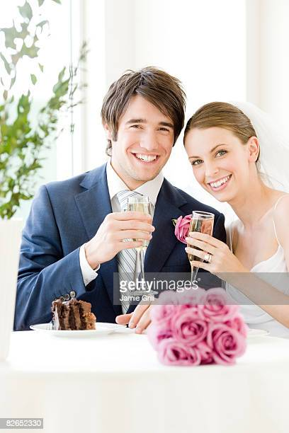 Bride and Groom toasting at Wedding