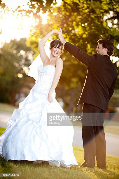 Bride and Groom Twirling and Dancing Together Outside