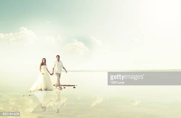 Bride and groom walking at beach