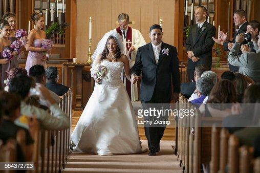 Wedding Songs Walk Down Aisle Church: Bride And Groom Walking Down Aisle During Wedding Ceremony