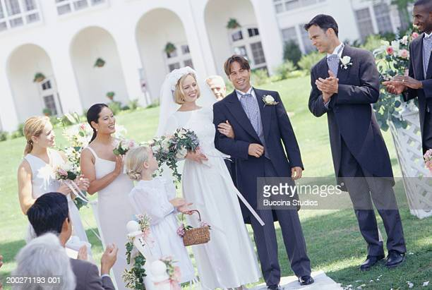 Bride and groom walking up aisle at wedding ceremony