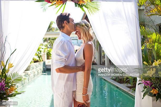 Bride and groom wedding ceremony tropical resort
