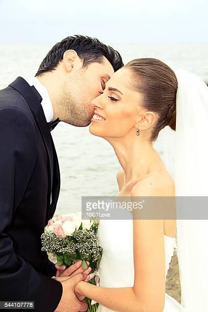bride and groom - wedding kiss
