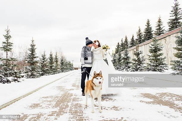 Bride and groom wedding with dog winter outdoor