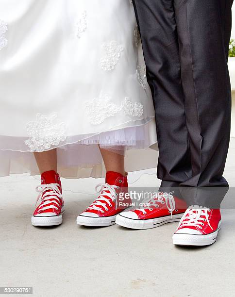 Bride and groom with red canvas sneakers