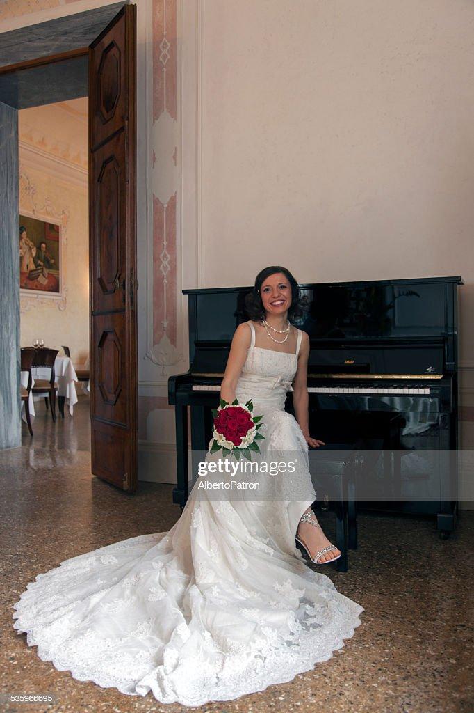 Bride and the piano : Stock Photo