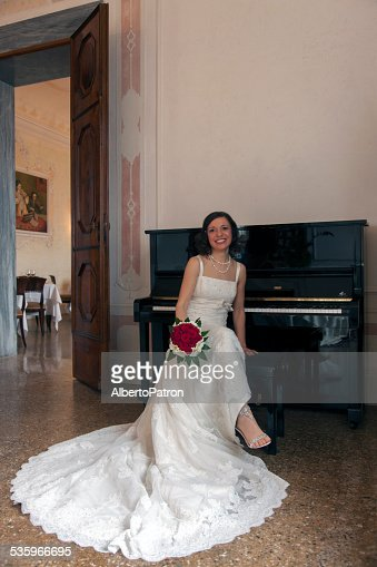 Bride and the piano : Stock Photo