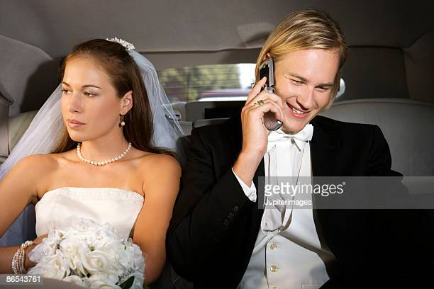 Bride annoyed at groom using cell phone