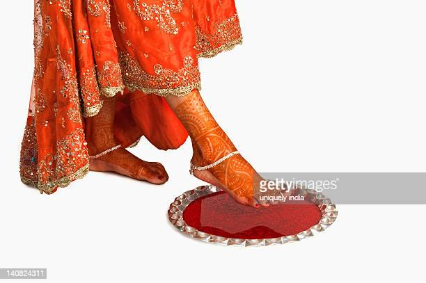 Bride at griha pravesh ceremony