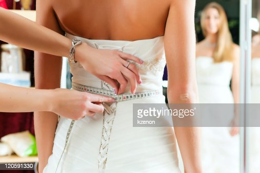 Bride at the clothes shop for wedding dresses : Stock Photo