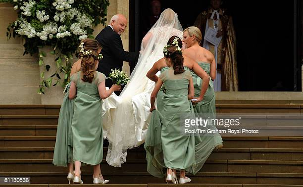 Bride Autumn Kelly arrives in the rain with her father Brian Kelly and her bridesmaids for her wedding ceremony at St George's Chapel in Windsor...