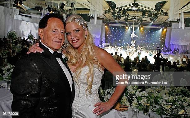 Bride Brynne Gordon and groom Geoffrey Edelsten pose for a photograph during the performance by Urban Cirque at the wedding of Geoffrey Edelsten and...