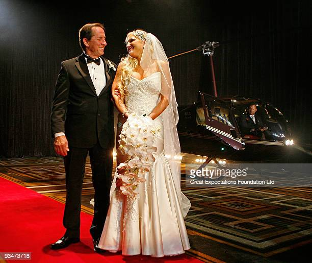 Bride Brynne Gordon looks at her father Don Gordon after alighting from a helicopter and before she walks down the aisle during the wedding of...